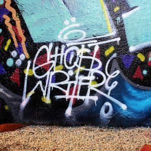 Spray-painted word Ghostwriter on wall